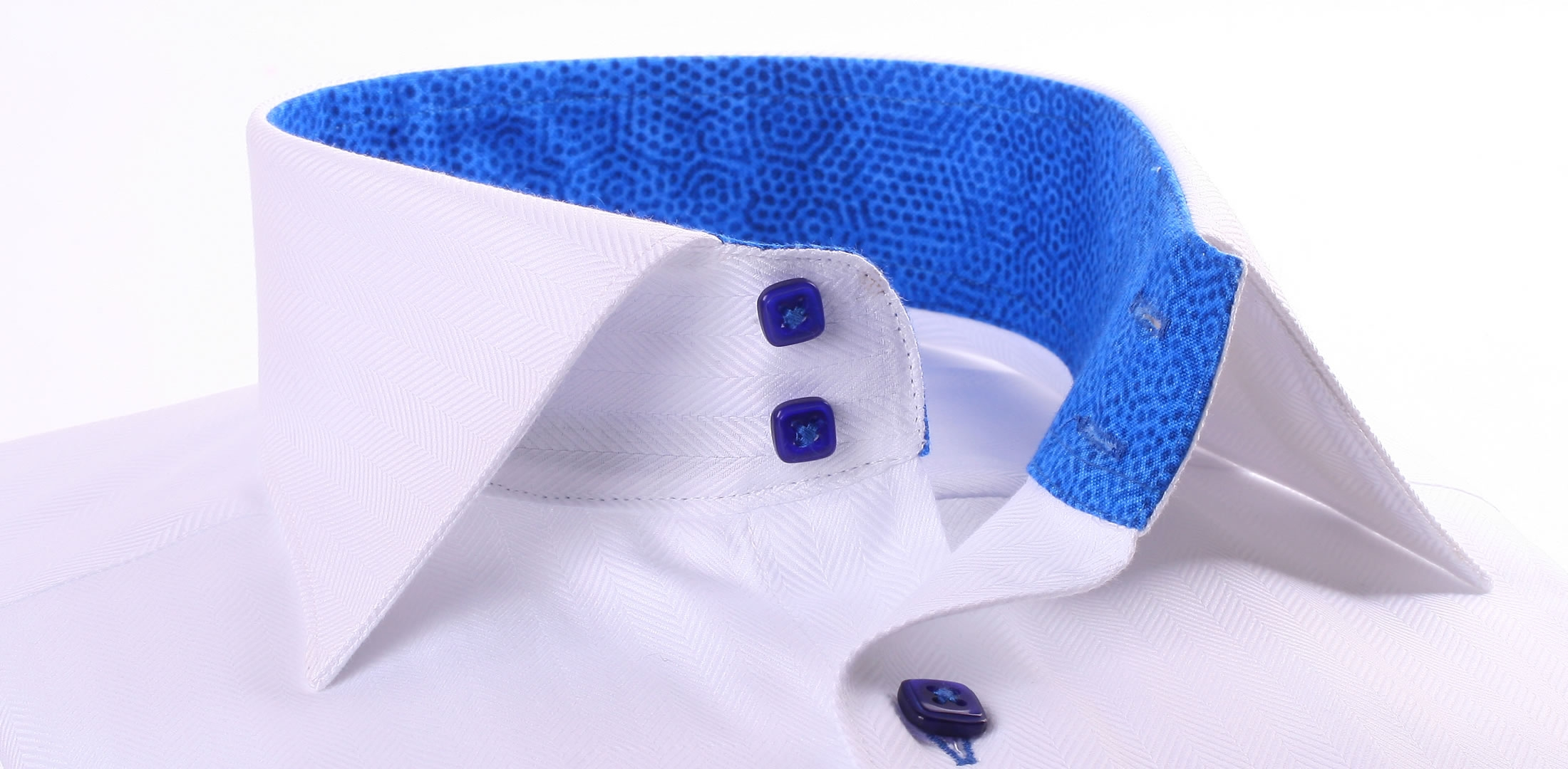 White shirt with a blue patterns collar and dark blue buttons